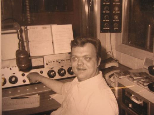 This is Jim Dandy's second time at WDGY-AM. This photo was taken in 1969 after he came back to replace Rob Sherwood when he left for KDWB-AM. The turntables (pre-historic CD players) are out of the shot to his left side.